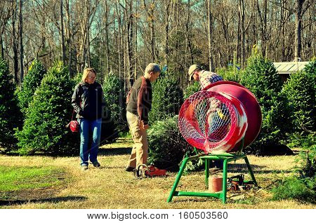 Pittsboro North Carolina - December 7, 2016: Husband and wife buying a Christmas tree at Phillips Farm of Chatham on Hanks Chapel Road