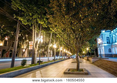 Tbilisi Georgia. The View Of Deserted Illuminated Pedestrian Platanus Alley On Rustaveli Avenue In Summer Evening.