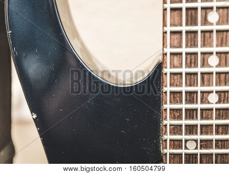 Dusty old seven string guitar in a home studio setting