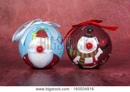 Two Christmas tree ornaments for the holidays
