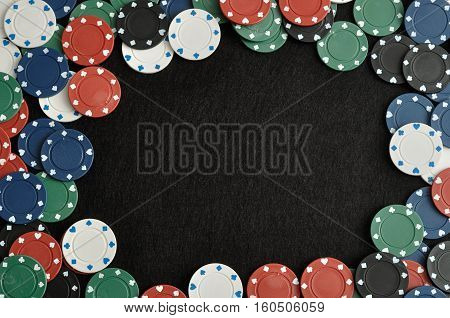 Poker chips forming a border with a black background