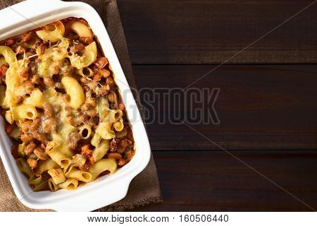 Chili con carne and macaroni pasta casserole in baking dish photographed overhead with natural light (Selective Focus Focus on the top of the casserole)