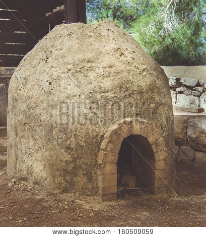 Old stone and brick wood fired oven in garden