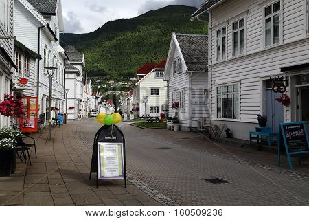 NORDFJORDEYD, NORWAY - JULY 5, 2016: This is the main street of the village with a retro buildings of the late 19th early 20th century.