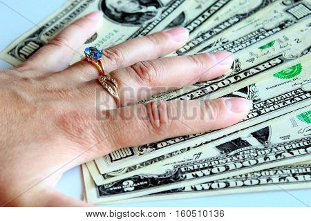 woman's hand purchasing the ring with topaz for dollars