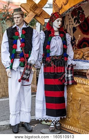 TIMISOARA ROMANIA - NOVEMBER 30 2016: Mannequins dressed with Romanian traditional clothes at a street fair. Specific for Maramures area.