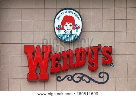 Oakland CA - December 06 2016: Wendy's fast food restaurant close up on sign. Wendy's is the world's third largest hamburger fast food chain with approximately 6650 locations.