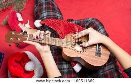 Girl Playing Ukulele For Christmas