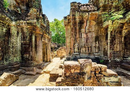 Ancient Mossy Buildings With Carving Of Ta Som Temple In Angkor