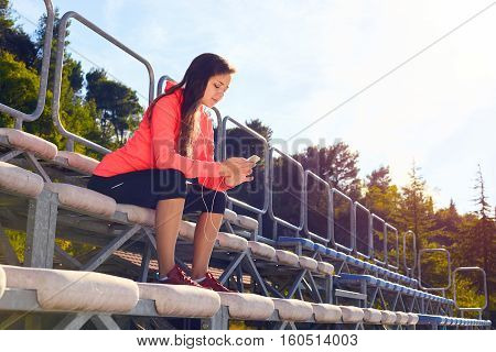 Woman Typing Message On Her Phone Outdoor.