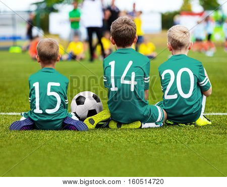 Football Game for Kids. Young Boys Soccer Players Athletes. Children Football Players at Match with Ball. Soccer Bench of Youth Team. Footballers in Green Sportswear