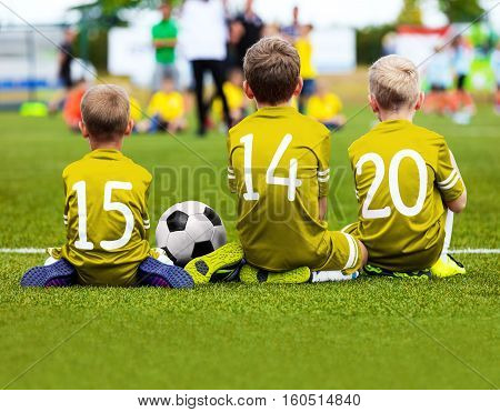 Football Game for Kids. Young Boys Soccer Players Athletes. Children Football Players at Match with Ball. Soccer Bench of Youth Team. Footballers in Yellow Golden Sportswear