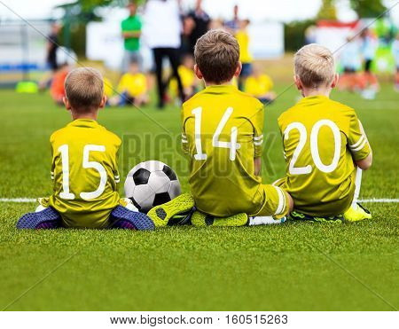 Football Game for Kids. Young Boys Soccer Players. Children Football Players at Match with Ball. Soccer Bench of Youth Sport Team. Little Kids in Golden Yellow Sportswear