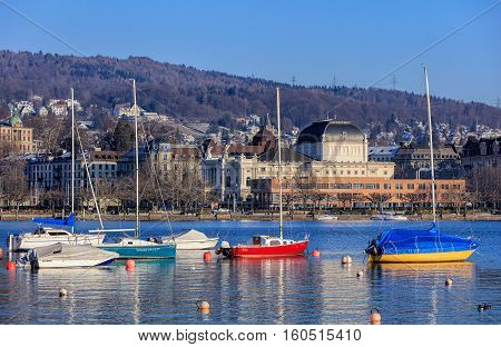 Zurich, Switzerland - 21 January, 2016: boats on Lake Zurich, people on the embankment of the lake and Zurich Opera House building in the background. Zurich is the largest city in Switzerland and the capital of the Swiss Canton of Zurich.