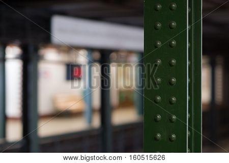 Girder detail on a dark subway station