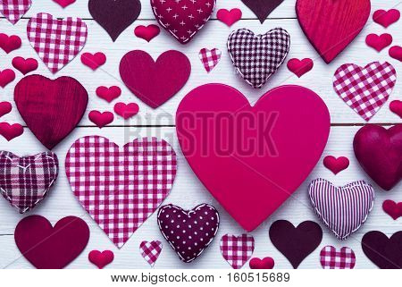 Purple Heart Texture With Copy Space For Advertisement Or Free Text. White Wooden Background. Textile Hearts Which Are Dotted and Striped. Greeting Card For Congratulations Or Valentines Day