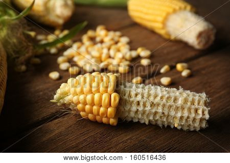 Corncobs and seeds on wooden rustic table