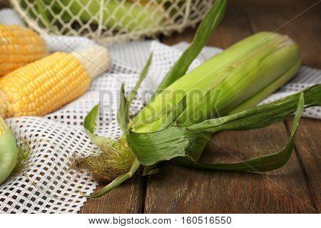 Fresh corncob on wooden rustic table
