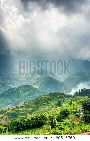 Hoang Lien Mountains And Rays Of Sunlight Through Storm Clouds