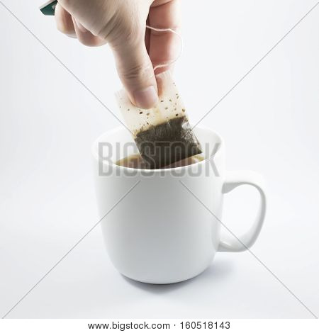 A white cup of tea and tea making.