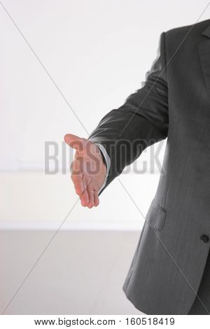 Businessman shaking hand to partner with succesful deal.