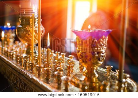 Interior Of Orthodox Church In Easter. baby christening. Ceremony of a christening in Christian church. bathing the baby into the baptismal font