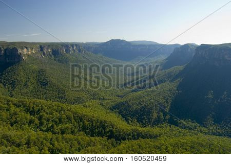 Picturesque view of the Blue Mountains New South Wales Australia with a forested valley between high mountain peaks