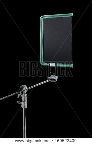 Film lighting equipment: A single scrim mounted on a c-stand.