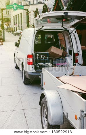 White van with trailer with diverse tool in trunk preparing to arrange the Christmas stall at the Baden-Baden Christmas market
