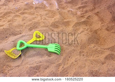 children's beach toys on sand rake and shovel plastic toys