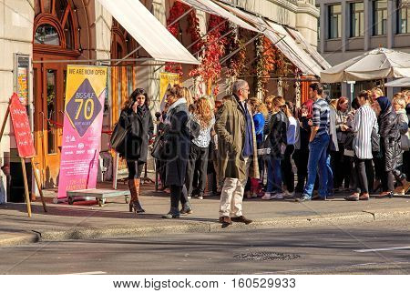 Zurich, Switzerland - 6 November, 2015: people waiting in a queue for a sale to begin. Zurich is the largest city in Switzerland and the capital of the Swiss Canton of Zurich.