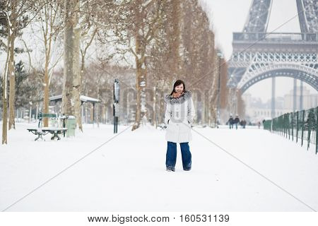 Beautiful Girl Walking By Champ De Mars At Winter Day