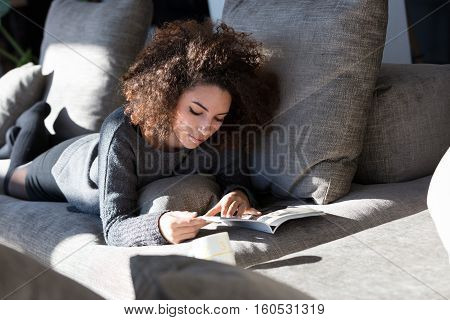 Rich Girl Reading Something On Her Sofa