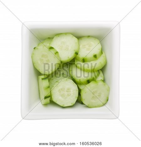Sliced Japanese cucumber in a square bowl isolated on white background