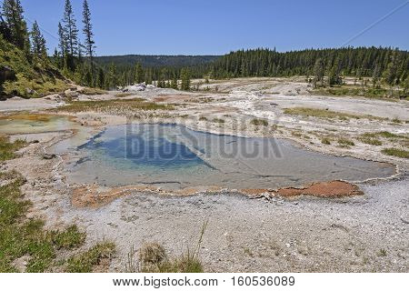 Colorful Pool in the Backcountry of the Shoshone Thermal Area in Yellowstone National park in Wyoming