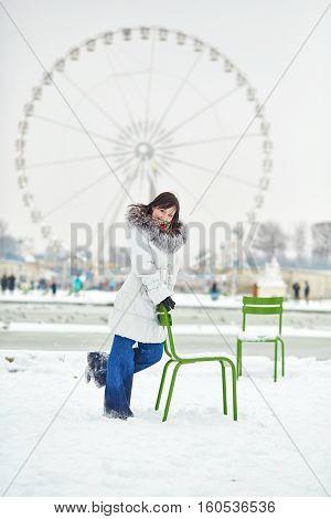 Girl Enjoying Rare Snowy Winter Day In Paris