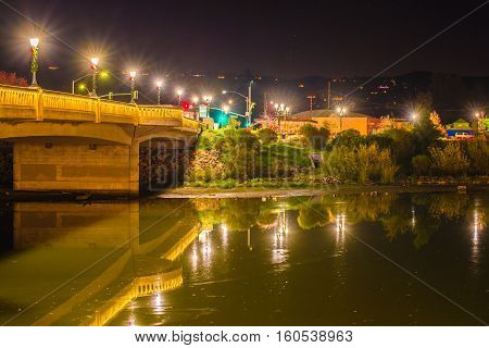 Reflections in river water in downtown napa valley