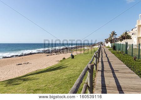 Wooden Walkway Against Blue Cloudy Sky At Ballito Beach