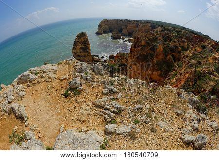 Fisheye view of scenic Praia da Marinha beach in Portugal