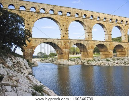 The Pont du Gard is a part of the ancient Roman Nîmes aqueduct that crosses the Gardon River in southern France.