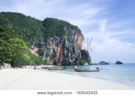 karst rock formations tower over railay beach in krabi southern thaiand
