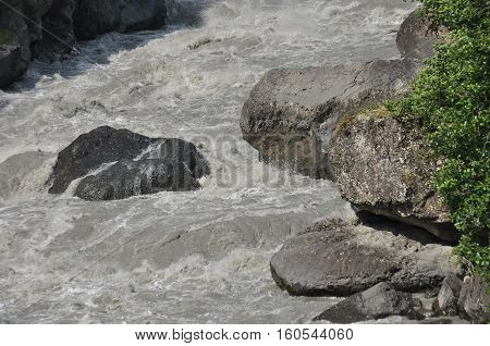 Inguri River. Georgia. Strong current and high level in the river. poster