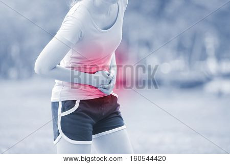 Sport girl have stomach pain in park great for your design