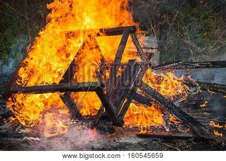 Burning Wooden Furniture In Big Bonfire