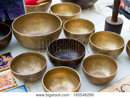 Tibetan Singing bowls are on the market counter