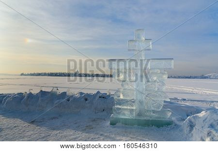 Ice cross in winter. Epiphany Orthodox holiday on a place of ice-hole swimming