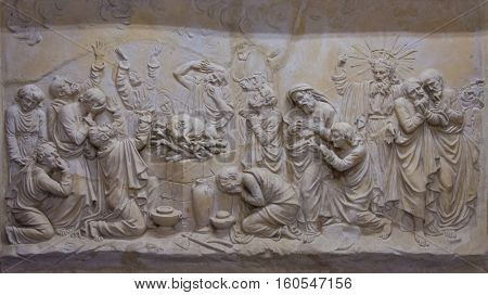 Bas-relief depicting the priests of Baal at the altar and prophet Elijah