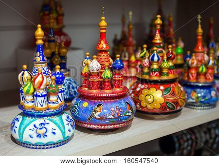 Moscow, Russia - February 12, 2016: Wooden souvenirs in the form of temple of Vasily Blazhenny stand on a shelf souvenir shop