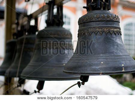 Vintage bronze church bells hanging on the belfry