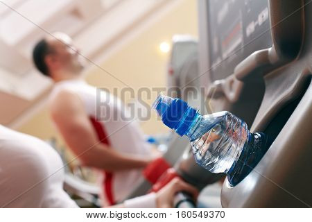 Close-up of water bottle on exercise machine